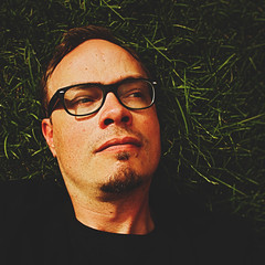 205 | 366 | V (Randomographer) Tags: project366 human man 366 face portrait self selfie glasses skin lips grass organic laying down day 205