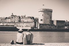 Relaxing in La Rochelle (Zeeyolq Photography) Tags: city couple holidays house houses larochelle noiretblanc relaxing tower vacances france aquitainelimousinpoitoucharentes