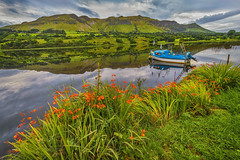 Glassey Glencar (Alan10eden) Tags: glencar lake leitrim ireland landscape view moutains reflection green fields scenery rugged boat flowers water inland lough alanhopps canon 80d 1022mm wideangle uwa fishing calm serene outdoors blueboat hills valleys