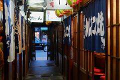 (  / Yorozuna) Tags:       ridoinshokugai ridobarstreet retroclassicbarstreet barstreet bar  izakaya       alley alleyway backalley  retro retrospective     evening night nightview nightfall nightshot  signboard sign   noren shopcurtain entrancecurtain japaneseshopcurtain japaneseentrancecurtain    kyoto kyotocity japan pentaxautotakumar55mmf18
