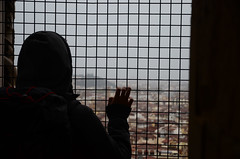 Rainy Day Florence (moke076) Tags: street vacation portrait italy man guy tower fence out grate florence hoodie nikon europe european afternoon hand looking cathedral bell random fingers foggy campanile rainy firenze through overlook hooded 2014 giottos d7000