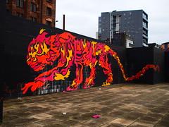 Glasgow Mural (creditflats) Tags: brick wall pen river prime scotland clyde mural glasgow tiger flames olympus zuiko m43 ep5 mzuiko