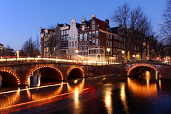Canal Corners (music_man800) Tags: city travel bridge blue winter light sunset vacation sky urban sun holiday cold holland reflection water netherlands car amsterdam bike set night reflections photography lights evening boat canal twilight europe long break traffic dusk travellers capital illuminations trails junction hour february waterway keizersgracht leidsegracht exposue twiliht