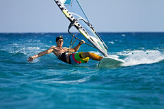 Young man surfing the wind in splashes of water (Maverick (Dima Fadeev)) Tags: ocean sea summer vacation sky sun man nature wet water sport speed flying
