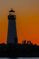 end of day and end of year.IMGP9733 - (candysantacruz) Tags: scphoto lighthouse sunset waltonlighthouse glow silhouettes people twinlakesbeach silhouette orange santacruz montereybay
