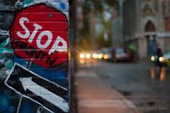 Stop Messing With Me (Sous l'Oeil de Sylvie) Tags: auto street city canada fall cars rain automne graffiti evening nightshot montréal pentax bokeh graf pluie stop québec nightlife soir rue ville octobre trottoir parapluie urbain urbaine flèche 2013 streeshot k30 50mmpentax prisedenuit prisederue sousloeildesylvie