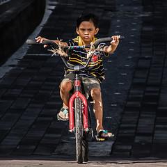 Bali 5 (kruser1947 (all killer no filler)) Tags: bali ubud indonesia child bicycle