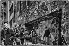 Street Gathering In The Rough (Rolf Siggaard) Tags: australia candid environmental fujix100s men melbourne mirrorless monochrome people photojournalism social street streetlife 23mmapsc niksilverefexpro2 x100s fujifilmx100s