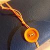 Arancio (La Stanza di Wendy) Tags: bottoni lastanzadiwendy quadernoinpelle rilegatura bookbinding