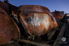 Knee Deep (mccrum) Tags: america empirestate newyork northamerica statenisland us usa unitedstates unitedstatesofamerica boat graveyard lightpainting longexposure newyorkcity night rust salvage