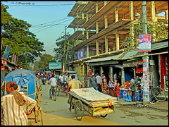 Bangladesh, Every Day Life (dark-dawud) Tags: bangladesh life town people busy shops women men children cart rickshaw streetlife bike cycles motorbike building cables wires sky sylhet habiganj timber wood handcart hot dust noise fruit smells sound litter trees humans happy
