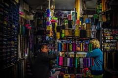Negotiation (Melissa Maples) Tags: woman man shop turkey beads nikon asia trkiye ella antalya vendor nikkor vr turk afs  18200mm  f3556g  18200mmf3556g d5100