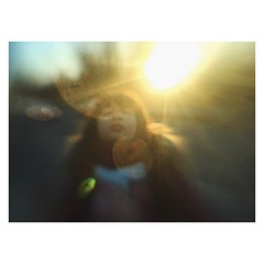 Mobile17 (Ana~Rosenberg) Tags: sunset girl mobile lensbaby child sunflare iphone sweetspot lm10 lbm10 seeinanewway