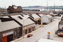 Trades Lane (Dundee City Archives) Tags: tradeslane old olddundeephotos dundee photos jute warehouses car garage victoriadock 1980s lada proton ronhutchesonmotorsltd shell petrol station smiley