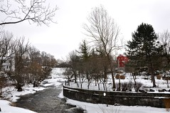 The Old Red Mill, Williamsville N.Y. ( Kimberly Collignon - All Rights Reserved) Tags: snowflake bridge november blue trees winter red sun white lake snow ny newyork cold building tree green bird history mill ice water leaves birds rock stone creek swimming river bench four snowflakes grey frozen duck pond buffalo mainstreet rocks stream december glow bright stones january ducks sunny brooke pebbles freeze historical glowing snowing brook willie temperature february icy freezer benches amherst watermill willy colder blustery babbling wintery wintry emptytree williamsville glenfalls oldredmill townofamherst villageofwilliamsvile