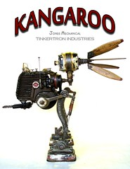 Kangaroo (Tinkerbots) Tags: art expedition make metal toys robot jones punk industrial noir handmade antique assemblage character alien creative machine retro explore foundobjectsculpture kangaroo pistol scifi laser boingboing z foundobjects outerspace deco past gears scrap salvage makebelieve remake foundobject prop waroftheworlds blaster galactic reuse steampunk machineage rayguns blasters assemblageart danjones mixedmedium junkart oldtech junksculpture industrialage foundobjectart assemblagesculpture dieselpunk laserguns odditie devicegallery tinkerbots tinkerbos steampunkweapon steampunkraygun tinkertronindustries