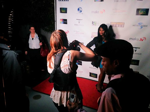 Queen Sabine Mondestin with paparazzi in Hollywood