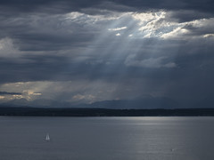 Across the Sound (allanga_69) Tags: seattle pugetsound olympics olympicmountains storm clouds crepuscularrays seascape waterscape dramatic bainbridgeisland sailboat pacificnorthwest
