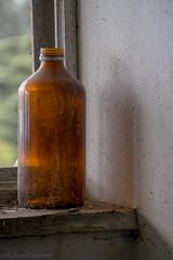 Empty bottle (rvanhegelsom) Tags: europe old urban urbex urbanexploration urbexworld urbxtreme rural portugal abandoned derelict hospital sanatorium indoors indoor bottle glass