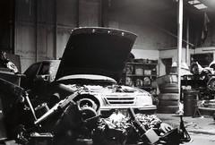 Brunswick (pablo.sutton) Tags: michaels 400iso ilfordhp5 50mmf18 nikonfm2n car mechanic parts engine tyres workshop hood bw blackandwhite filmisnotdead film analogue noiretblanc