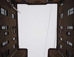 Caught between (mikhail_mih) Tags: old windows sky urban building up look weather yard buildings court town spring gray cybershot courtyard well special wires across between dschx50 sonydschx50