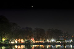 Under a crescent moon [explored 10-1-2015] (ChrisBrn) Tags: trees moon lake night reflections lights crescent