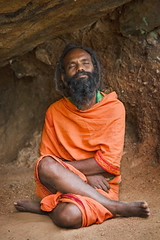 Sadhu meditating in cave (Dmitry Rukhlenko Travel Photography) Tags: portrait people india mountain man male beard asian religious concentration colorful asia meditate nirvana indian traditional religion culture monk holy yogi cave priest meditation spirituality wisdom spiritual enlightenment hindu hinduism bearded sadhu saffron guru ascetic asceticism