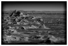 Badlands Tilt Shift (chadbrowngraphics) Tags: road park trip bw white black landscape ancient south shift illusion national badlands rough tilt desolate dakota burned distant seabed