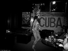 Cuba (Neil. Moralee) Tags: uk blackandwhite bw woman white black girl monochrome hat female club dinner diamonds dark bristol table mono restaurant nikon highheels dancing eating flash havana cuba feathers neil social cigar dancer sparkle exotic bikini meal vista rum guest flashy moralee neilmoralee aw110