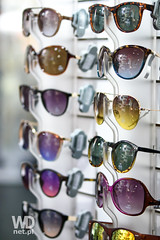 Trendy and colorful sunglasses (WDnet) Tags: summer vacation eye sunglasses fashion shop modern shopping lens glasses stand store colorful commerce display market designer sale many group optical style selection center shelf business rack shade frame trendy d750 choice eyeglasses protection luxury optician eyewear accessory eyeglass