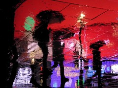 Circus Ghosts XX (Douguerreotype) Tags: umbrella urbex street red lights city night tourism rain uk british england silhouette gb britain reflection piccadillycircus london upsidedown urban water people light