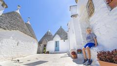 Taking a break in the shade (Stefano Laurita) Tags: italy nikon d7000 puglia trulli alberobello sunny architecture child colors italia sigma 1020