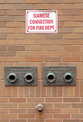 Siamese Connection (philipbouchard) Tags: siameseconnection standpipe twins firedepartment portland maine sprinkler unusual pipes firefighting brickwall brass sign
