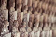 Jizo Bokeh (campra) Tags: japan hirosaki  aomori  choshoji  temple buddhist tsugaru jizo statue wood statuette