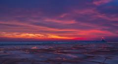 Fading light (tquist24) Tags: longexposure winter sunset sky lighthouse reflection ice clouds reflections geotagged evening nikon unitedstates michigan stjoseph lakemichigan saintjoseph stjosephharbor cloudsstormssunsetssunrises nikond5300