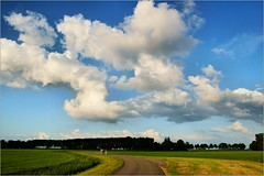 Evening Ride (Hindrik S) Tags: clouds evening ride bike bicycle pair pear koppel paar field green cloud cloudhunting wolken wolk sky loft luft heaven lucht landscape landschap nederland nederlandvandaag netherlands fryslân friesland jelsum sonyphotographing sony sonyalpha slta57 α57 a57 tamron tamron1750 tamronspaf1750mmf28xrdiiildasphericalif alpha amount