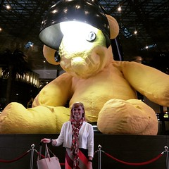At the yellow teddy bear in Hamad Intl Airport in Doha #DOH with Emily!