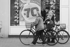 Biking together (chat des Balkans) Tags: old blackandwhite bw bike bicycle noiretblanc serbia streetlife oldman elder oldwoman streetphoto oldpeople velo vojvodina srbija voivodina photoderue serbie streetpicture vieilhomme vrsac personnesages twobikes femmeagee bikingtogether serbiastreet ruedeserbie voivodine lifeinserbia vieenserbie serbiastreetphoto deuxvelos oldpeoplebiking personnesgeesfaisantduvelo lifeinvrsac