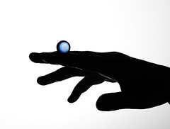 Blue (Karen_Chappell) Tags: blue white black glass ball circle hand fingers orb sphere round marble