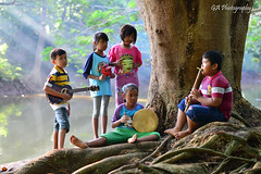 PLAYING MUSIC (GA Natural Light Photography) Tags: human cute photography humaninterest pop popular dailylife dailyactivity amazingphoto amazingpicture stunning nature bokeh asian indonesia jakarta photographer event new pink face yellow family people green garden me children child serene portrait creative art lighting