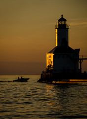 A Beacon in the Light (Carl's Captures (Away)) Tags: lighthouse michigancityindiana lakemichigan thegreatlakes powerboat sunset dusk evening summer july shoreline laportecounty landscape harbor breakwater washingtonpark beacon foghorn outdoors seascape goldenhour nautical marine maritime pleasurecraft vessel silhouette historical nostalgia history nikond5100 tamron18270 lightroom5 michiana horizon beach dunes beachfront lakeshore shadows navigation landmark approach architecture cabadil