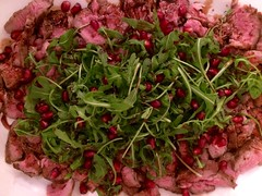 Lamb with pomegranate seeds.