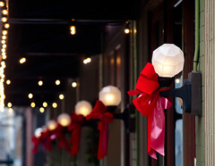 Lamposts in a Row (Orbmiser) Tags: autumn red fall oregon portland awning lights nikon sidewalk lamps bows d90 55200vr