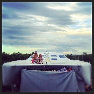 057/365 • waiting to see if the clouds bring rain • #057_2015 #catamaran #liveaboard #4yo #7yo #M #nearlybedtime #trampolines #blindbight #carsandboatneedawash