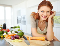 About to whip together an awesome salad! (The Daniel Plan) Tags: portrait people food woman home cooking kitchen beautiful smile smiling modern female standing happy person one women pretty counter adult natural gorgeous board young happiness indoor vegetable fresh redhead meal ingredients attractive casual produce positive choice copyspace product relaxed leaning enjoying assortment radiant assorted freshness caucasian handonchin