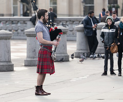 Bagpiper in Trafalgar Square (silabob) Tags: light portrait people london trafalgarsquare bagpipes february bagpiper canon70200mmf4lusm
