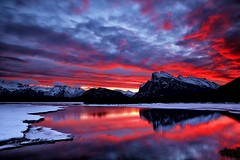 Red hot Sunrise (John Andersen (JPAndersen images)) Tags: blue red snow mountains fall ice sunrise cloudy alberta banff vermillionlake