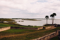 Castillo de San Marcos (J. Parker Natural Florida Photographer) Tags: old morning history water sailboat vintage dock florida cloudy fort colonial oldness overcast medieval historic retro faded palmtree historical grainy fortification staugustine waterway muted intercoastalwaterway rampart castillodesanmarcos a1a saintaugustine tidewater matanzasriver vsco colonialfort vscofilm vilanobeachbridge