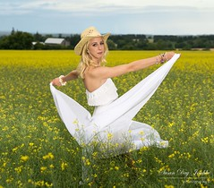 DSC_0375b wm web (Susan Day-Jeschke) Tags: flowers blue sunset summer white green field yellow rural pose model cowboy dress photoshoot farm vibrant blueeyes posing blonde blondehair cowboyhat modelling brilliant canola whitedress canolafield