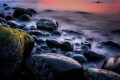 Boulders at Sunset (Les Ellingham) Tags: ocean longexposure ireland sea london rocks europe clare unitedkingdom boulders ie countyclare